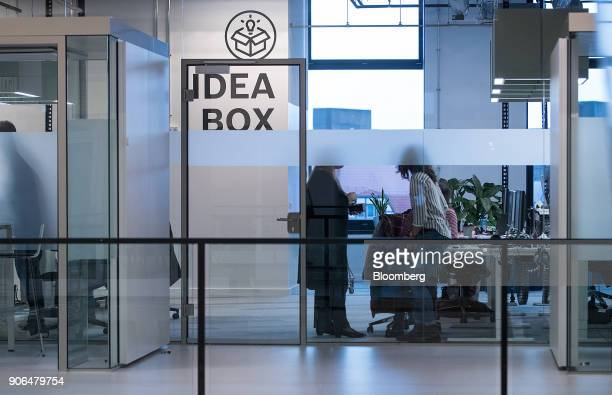 Employees work in a glass walled office as Robert Bosch GmbH opens an Internet of Things campus in Berlin Germany on Thursday Jan 18 2018 Germanys...