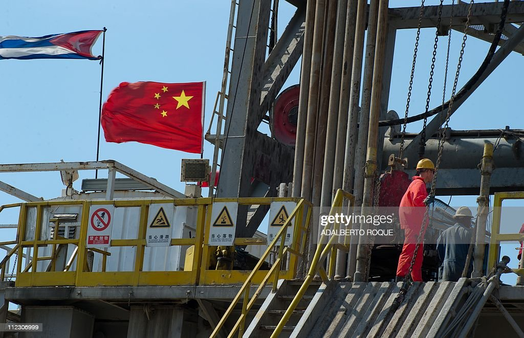 Employees work in an oil rig operated by : News Photo