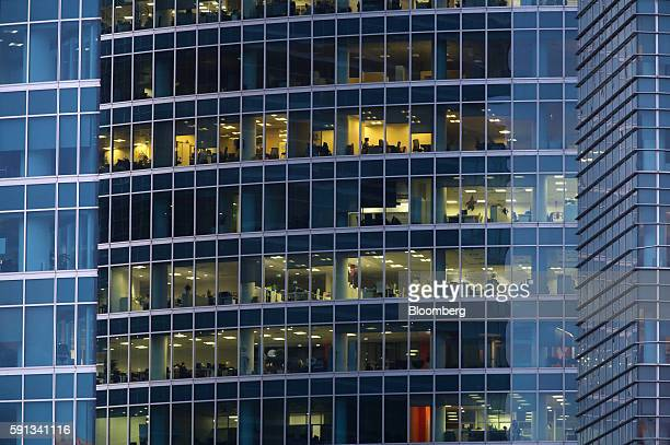 Employees work in commercial offices in a skyscraper at the Moscow International Business Center also known as Moscow City in Moscow Russia on...