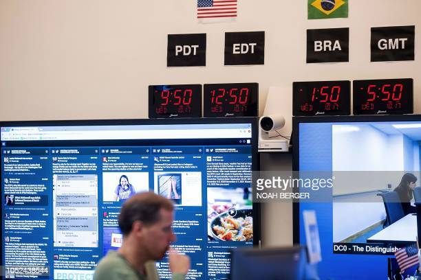 Employees work in Facebook's War Room during a media demonstration on October 17 in Menlo Park California The freshly launched unit at Facebook's...