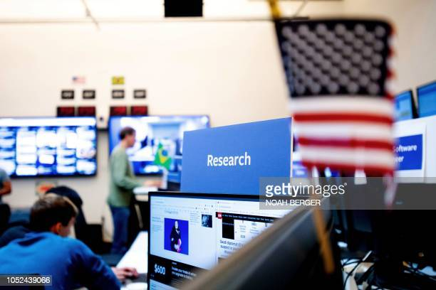 "Employees work in Facebook's ""War Room,"" during a media demonstration on October 17 in Menlo Park, California. - The freshly launched unit at..."
