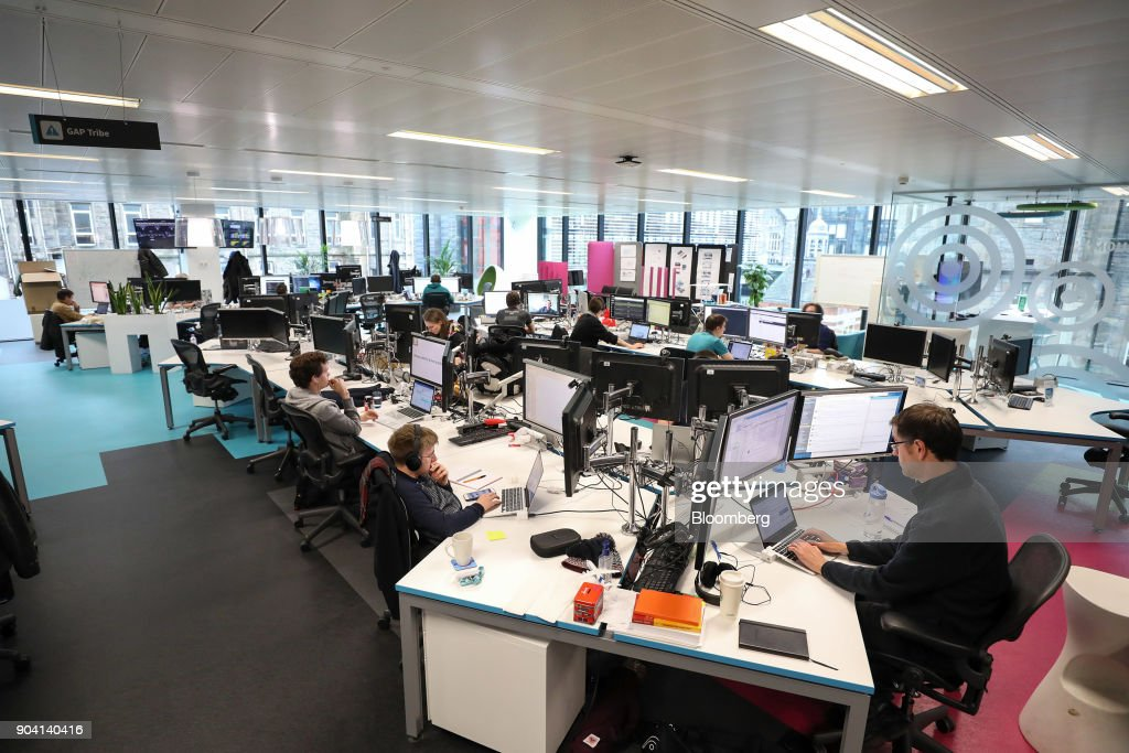 Employees work in front of computer screens at Skyscanner Ltd.'s headquarters in Edinburgh, U.K., on Tuesday, Feb. 7, 2017. More coders are choosing to live in Edinburgh over London, according to a report by developer community Stack Overflow, reported the Scotsman in Dec. 2017. Photographer: Chris Ratcliffe/Bloomberg via Getty Images