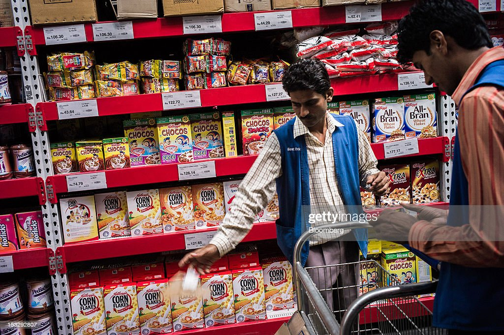 Employees work in front of shelves displaying boxes of Kellogg Co cereals at a Bharti Walmart Pvt Ltd Best Price Modern Wholesale store in Zirakpur...