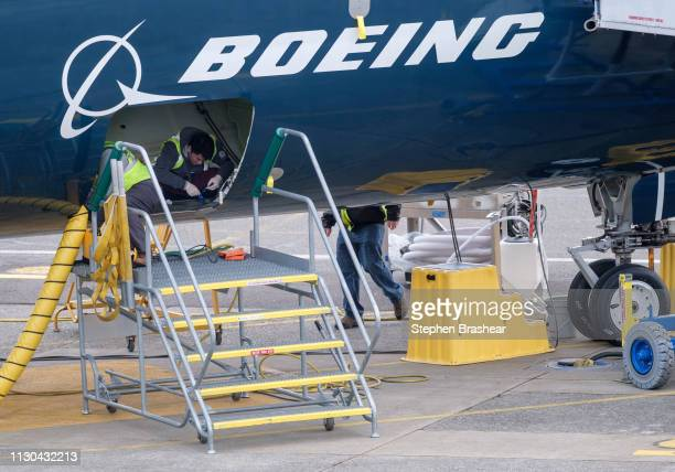 Employees work in the cargo hold of a Boeing 727 MAX 9 test plane outside the company's factory on March 14 2019 in Renton Washington The 737 MAX...