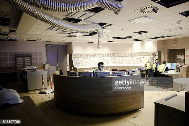 Employees work in the control room inside the Evolutionary Power Reactor nuclear power plant operated by Electricite de France SA in Flamanville...