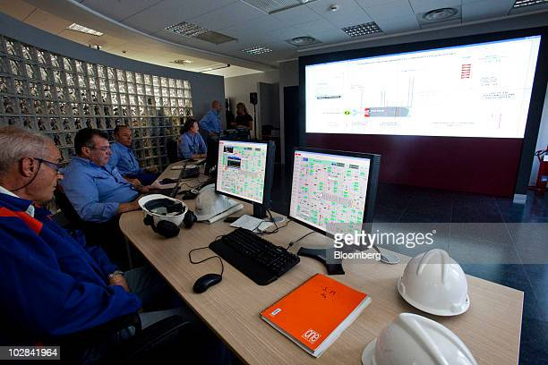Employees work in the control room of the world's first industrialscale hydrogen plant owned by Enel SpA in Fusina near Venice Italy on Monday July...