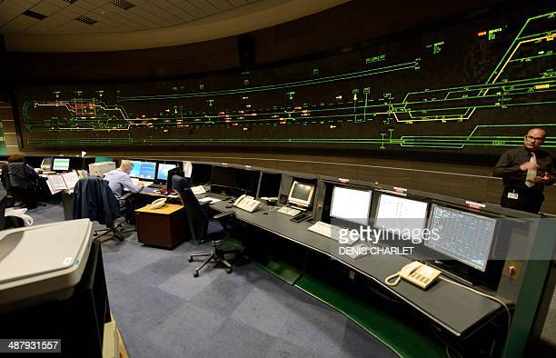 Employees work in the EuroTunnel control room on April 10, 2014 in Folkestone, southern Britain. Twenty years ago, Queen Elizabeth II and President...