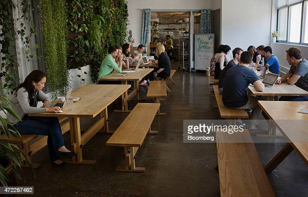 Employees work in the greenhouse at Etsy Inc headquarters in the Brooklyn borough of New York US on Monday May 4 2015 Etsy Inc a marketplace for...