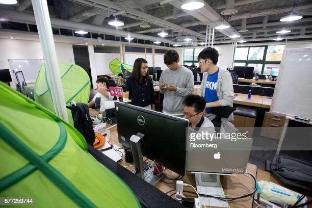 Employees work in the office at the Yanolja Co headquarters in Seoul South Korea on Tuesday Oct 10 2017 Yanolja Korean for 'hey let's play' is the...