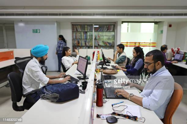 Employees work in the office of Vishwas News, operated by Jagran New Media, in New Delhi, India, on Friday, May 17, 2019. Facebook, Twitter Inc. And...