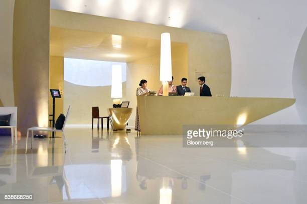 Employees work in the reception at the Roseate New Delhi hotel operated by the Bird Group in New Delhi India on Saturday Aug 19 2017 The Roseate on...