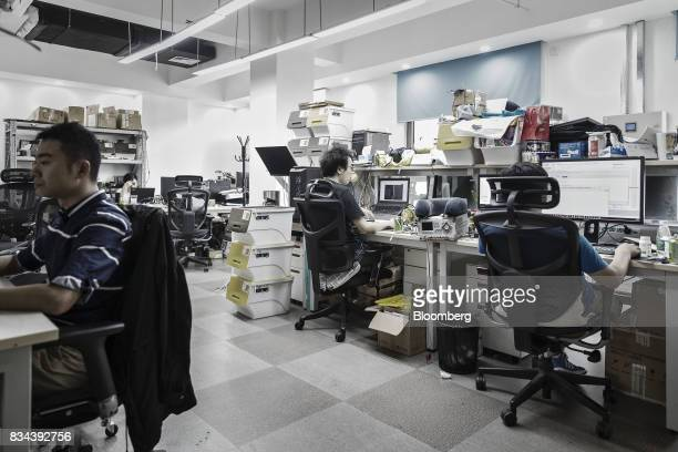 Employees work in the research and development department at Bitmain Technologies Ltd's headquarters in Beijing China on Thursday Aug 10 2017...