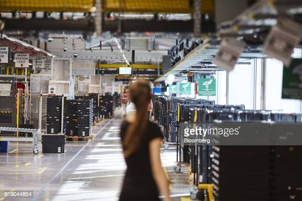 Employees work in the robotics field unit at Amazoncom Inc's new fulfillment center in Kolbaskowo Poland on Friday Feb 16 2018 Both academic and...