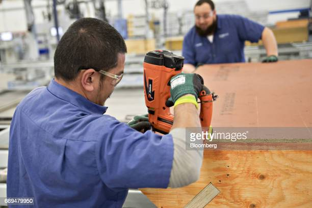 Blueprint robotics stock photos and pictures getty images employees work in the roof assembly area of the blueprint robotics facility in baltimore maryland us malvernweather Choice Image