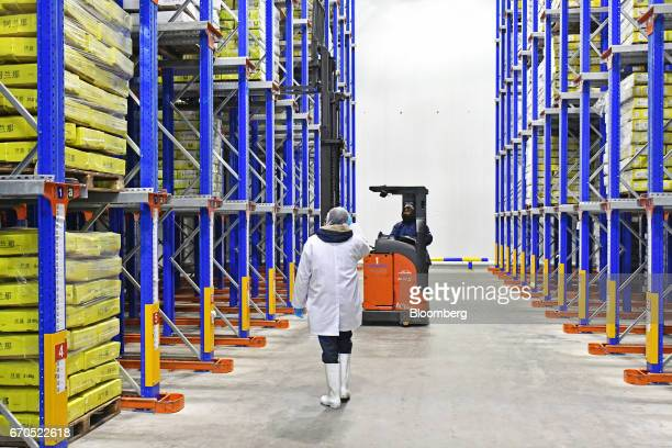 Employees work inside a cold storage unit at a plant operated by Allana Group in Aligarh Uttar Pradesh India on Tuesday April 11 2017 Allana a...
