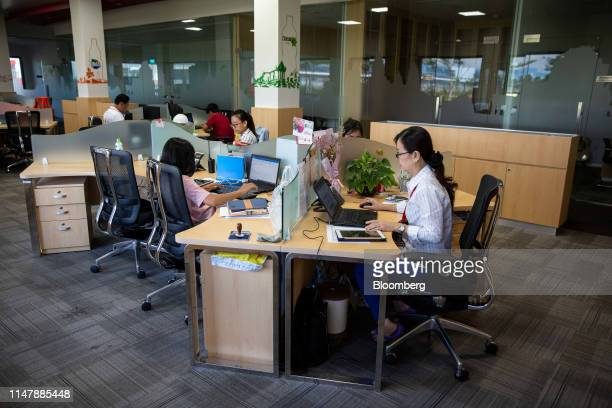 Employees work inside an office at the CocaCola Cambodia Bottling Plant operated by Cambodia Beverage Co which is a subsidiary of CocaCola in Phnom...