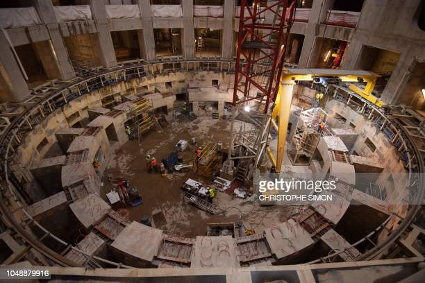Employees work inside the ITER construction site where will be installed the Tokamak, a confinement device being developed to produce controlled...