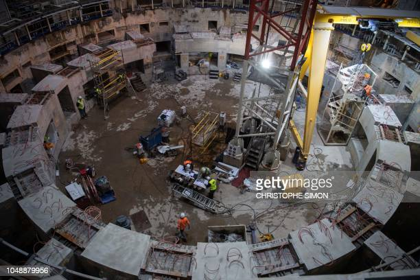 Employees work inside the ITER construction site where will be installed the Tokamak a confinement device being developed to produce controlled...