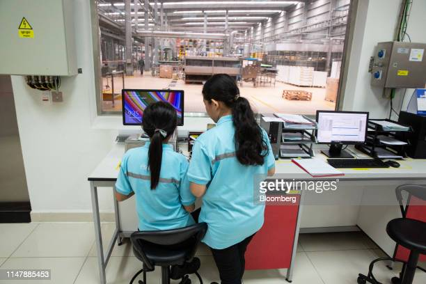 Employees work inside the laboratory at the CocaCola Cambodia Bottling Plant operated by Cambodia Beverage Co which is a subsidiary of CocaCola in...