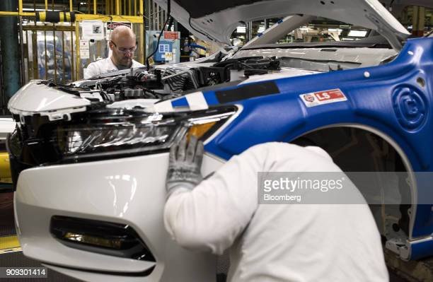 Employees work on a 2018 Honda Accord vehicle during production at the Honda of America Manufacturing Inc Marysville Auto Plant in Marysville Ohio US...