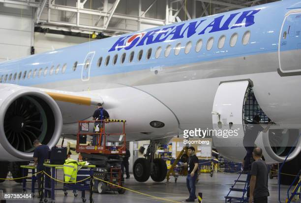 Employees work on a Bombardier Inc CS300 airplane with a livery for Korean Air Lines Co at the Bombardier hangar in Mirabel Quebec Canada on Friday...