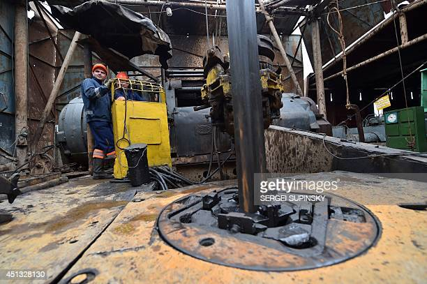 Employees work on a gas drilling rig in the biggest Ukrainian gas extraction site near Poltava eastern Ukraine on June 27 2014 Ukraine on June 252014...