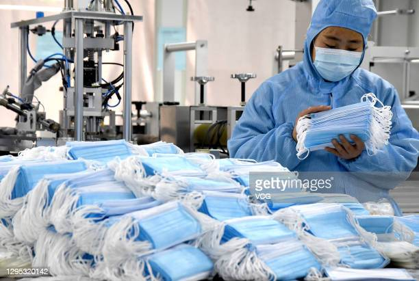 Employees work on a production line of disposable medical masks at a factory of Hebei Shengzhuo Medical Equipment Co., Ltd on January 8, 2021 in...