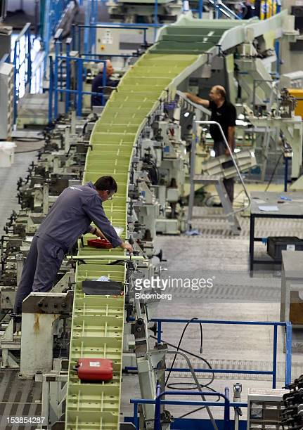 Employees work on a trailing wing edge for an Airbus SAS A380 aircraft a unit of European Aeronautic Defence Space Co at GKN Plc's Aerospace factory...