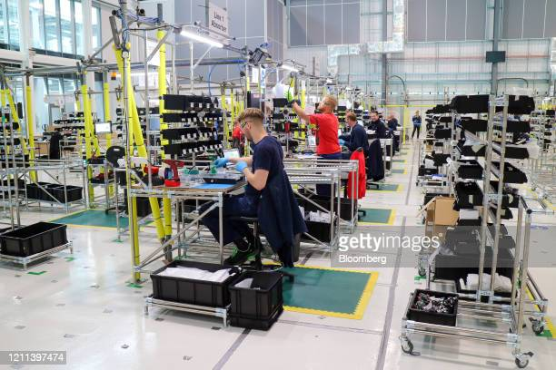 Employees work on a ventilator production line in an adapted hangar at the Airbus SE assembly plant in Broughton UK on Thursday April 30 2020...