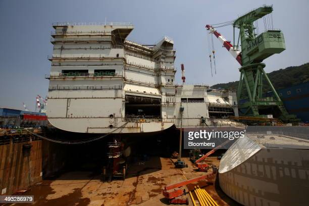 Employees work on a vessel under construction at the Hyundai Mipo Dockyard Co shipyard an affiliate of Hyundai Heavy Industries Co in Ulsan South...