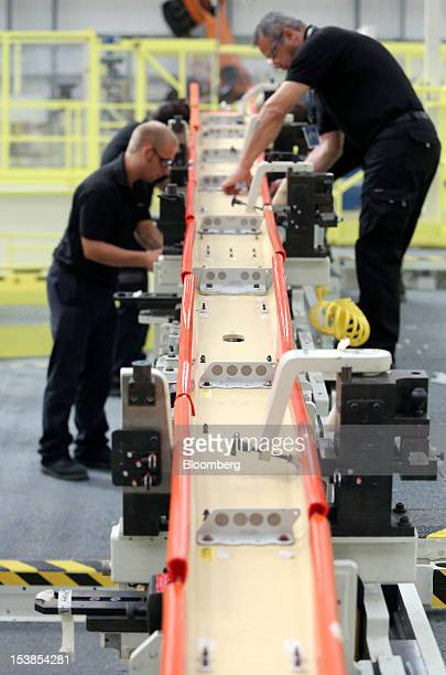 Employees work on a wing component for an Airbus SAS A350 aircraft a unit of European Aeronautic Defence Space Co at GKN Plc's Aerospace factory in...