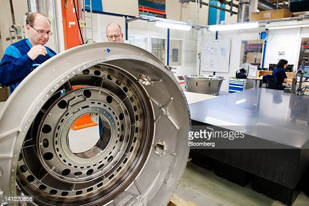 Employees work on an aircraft engine component at the Volvo Aero factory a division of Volvo AB in Trollhaettan Sweden on Monday March 12 2012 GKN...