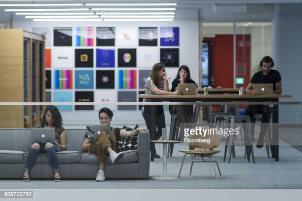 Employees work on Apple Inc MacBook laptops inside the Square Inc headquarters in San Francisco California US on Wednesday Aug 2 2017 Square's...