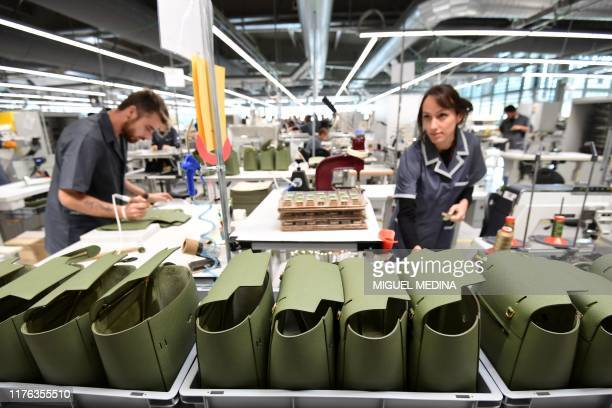 "Employees work on Celine handbags at ""La Manufacture"", Celine's new factory in Radda in Chianti, south of Florence, Tuscany, on October 17, 2019 on..."