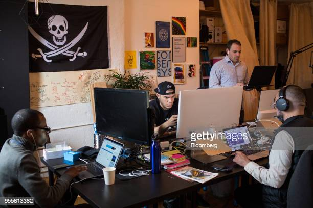 Employees work on computers at the ConsenSys Inc office in the Brooklyn borough of New York US on Thursday March 29 2018 The employees ofConsenSys...