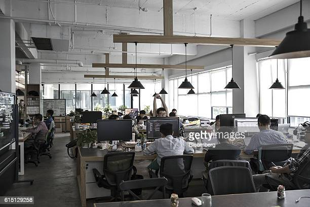 Employees work on computers at the office of Musically Inc in Shanghai China on Sunday Oct 9 2016 Musically has raised more $100 million at about a...
