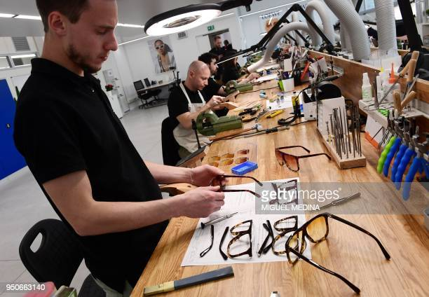 Employees work on glasses frames at Thelios plant the first LVMH eyewear factory opened in partnership with the Italian eyewear manufacturer Marcolin...