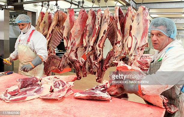 Employees work on June 16 on the frozen ground beef production line at the French company SEB in SaintDizier eastern France Six children are being...