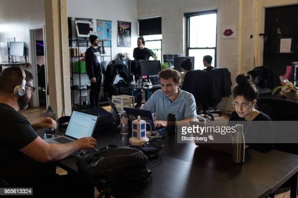 Employees work on laptop computers at the ConsenSys Inc office in the Brooklyn borough of New York US on Thursday March 29 2018 The employees...