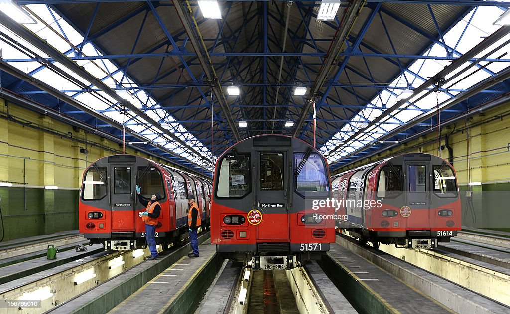 Employees work on London Underground Northern Line trains at Alstom SA's Traincare Centre in the Golders Green district of London, U.K., on Wednesday, Nov. 21, 2012. Transport for London (TFL), who oversee the U.K. capital's public transport system, issued 300 million pounds ($476 million) of bonds five months ahead of schedule to take advantage of investor demand as it continues its 35 billion-pound transport investment program. Photographer: Chris Ratcliffe/Bloomberg via Getty Images