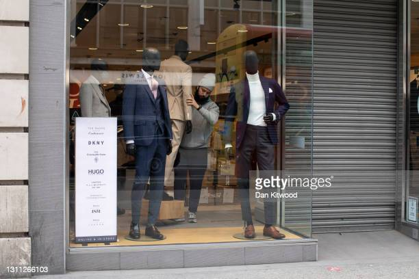 Employees work on new window displays on Oxford Street on April 07, 2021 in London, England. All non-essential retail will be able to reopen from...