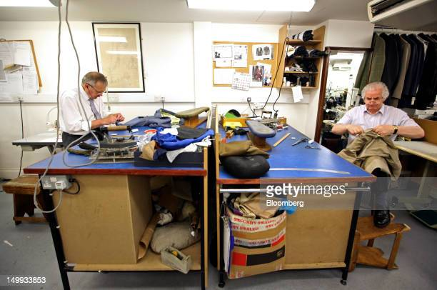 Employees work on suits in the workshop at the Gieves Hawkes store owned by Trinity Ltd on Saville Row in London UK on Tuesday Aug 7 2012 UK retail...