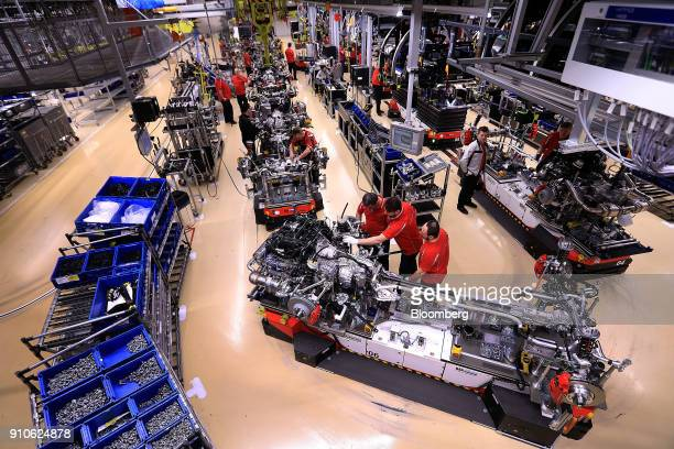 Employees work on suspension systems on the production line inside the Porsche AG luxury automobile factory in Stuttgart Germany on Friday Jan 26...