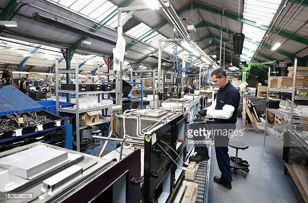 Employees work on the AGA range cooker production line at AGA Rangemaster Plc's plant in Telford UK on Tuesday Oct 1 2013 Euroarea factory output...