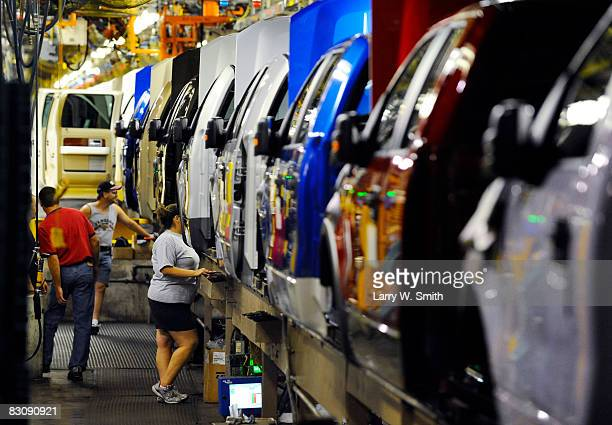 Employees work on the assembly line for the F150 pickup at the Kansas City Ford Assembly plant October 2 2008 in Claycomo Missouri Ford's Kansas City...