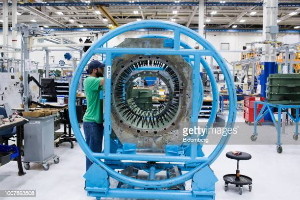 Employees work on the assembly line of the Boeing Co F15 Strike Eagle fighter aircraft at the Boeing Defense Space Security facility in St Louis...