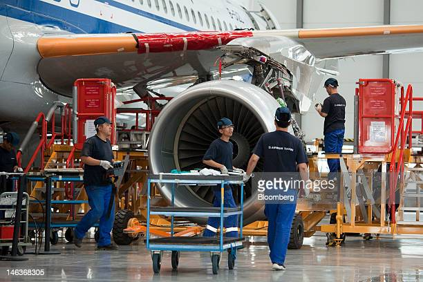 Employees work on the assembly of an Airbus SAS A320 airplane at the company's plant in Tianjin China on Wednesday June 13 2012 Mainland China will...