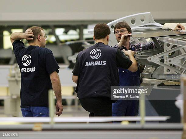 Employees work on the assembly of the tail of an Airbus A380 at the Airbus factory March 6 2007 at Stade in northern Germany Airbus has announced...