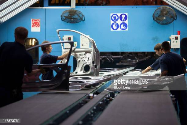 Employees work on the assembly of vehicle doors on the production line at OOO GestampSeverstalKaluga a steel stamping company for automobile...