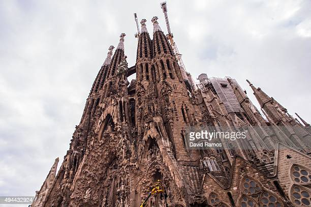 Employees work on the Birth's Facade of 'La Sagrada Familia' on October 26 2015 in Barcelona Spain 'La Sagrada Familia' Foundation announced on...